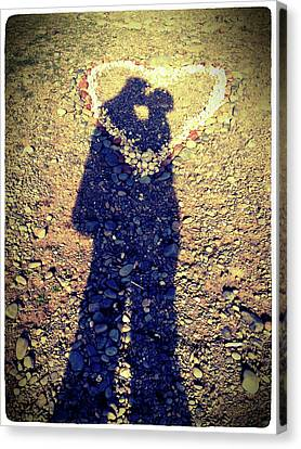 Shadows Of Couple Kissing Over Heart Of Stones Canvas Print by Daniel MacDonald / www.dmacphoto.com