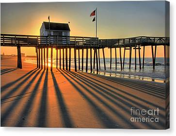 Shadows On The Shore Canvas Print by John Loreaux