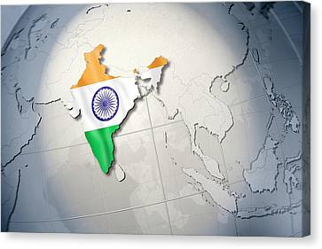 Shape And Ensign Of India On A Globe Canvas Print by Dieter Spannknebel