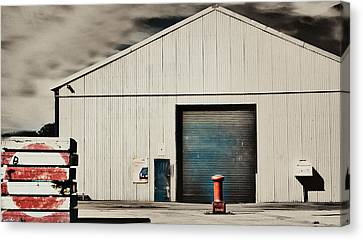 Shed With Bollard And Pallets Canvas Print by Harry Neelam