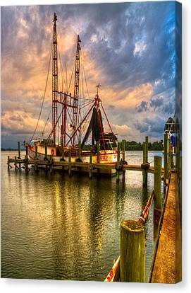 Shrimp Boat At Sunset Canvas Print by Debra and Dave Vanderlaan