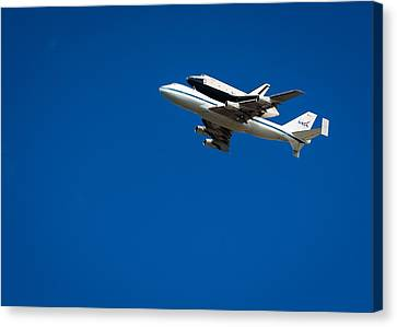 Shuttle Enterprise Through A Clear Sky Canvas Print by Anthony S Torres