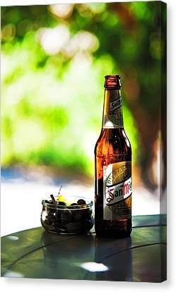 Siesta Time. Beer And Olives Canvas Print by Jenny Rainbow