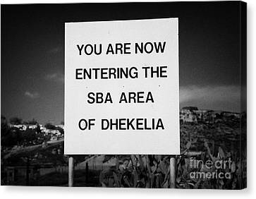 sign marking entrance of SBA Sovereign Base area of Dhekelia in the british controlled cyprus Canvas Print by Joe Fox
