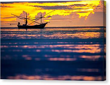 Silhouette Boat At Sea Canvas Print by Arthit Somsakul
