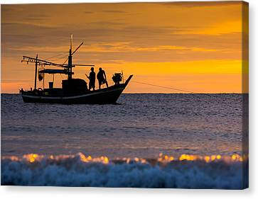 Silhouette Fisherman On Boat In Sunset Huahin Canvas Print by Arthit Somsakul
