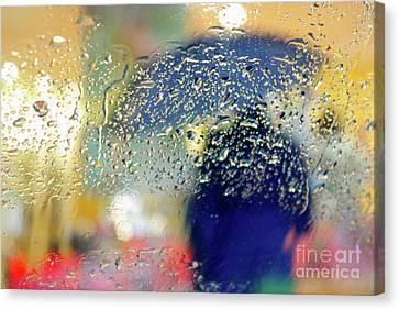Silhouette In The Rain Canvas Print by Carlos Caetano