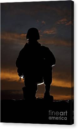 Silhouette Of A U.s. Marine In Uniform Canvas Print by Terry Moore