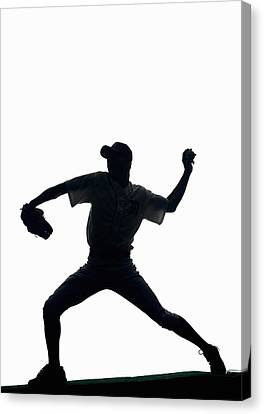 Silhouette Of Baseball Pitcher About To Pitch Canvas Print by PM Images