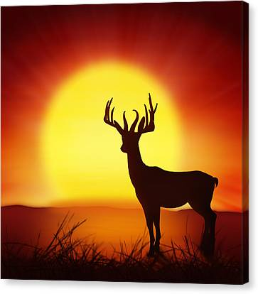 Silhouette Of Deer With Big Sun Canvas Print by Setsiri Silapasuwanchai