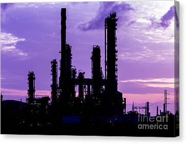 Silhouette Of Oil Refinery Plant At Twilight Morning Canvas Print by Mongkol Chakritthakool