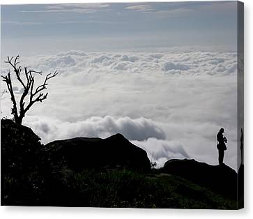 Silhouette Photographer With Group Of Clouds And Fogs Canvas Print by Nawarat Namphon