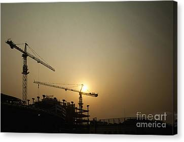 Silhouetted Construction Cranes Canvas Print by Shannon Fagan