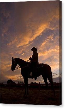 Silhouetted Cowboy Actor On Horseback Canvas Print by Ralph Lee Hopkins