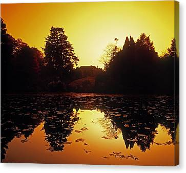 Silhouetted Home And Trees Near Water Canvas Print by The Irish Image Collection