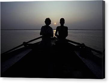 Silhouettes Of Boatmen Rowing At Dawn Canvas Print by Jason Edwards