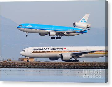 Klm Canvas Print - Singapore Airlines And Klm Airlines Jet Airplane At San Francisco International Airport Sfo 7d12153 by Wingsdomain Art and Photography