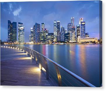 Singapore Skyline Seen Over Marina Bay Canvas Print by Travelpix Ltd