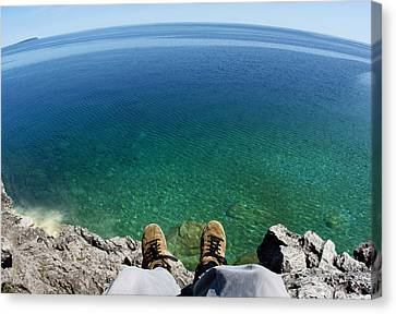 Sitting On A Cliff Canvas Print by Cale Best