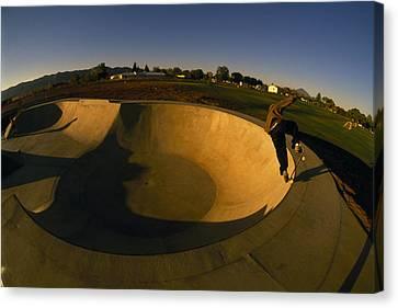Skateboarding In A Skate Park Canvas Print by Bill Hatcher