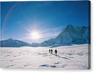 Skiers Approaching Mount Tyree Canvas Print by Gordon Wiltsie