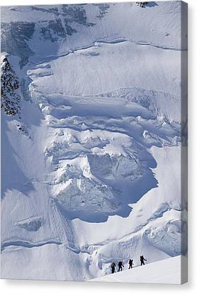 Skiers Cross The Aletsch Glacier En Canvas Print by Axiom Photographic