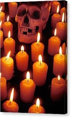 Flickering Light Canvas Print - Skull And Candles by Garry Gay