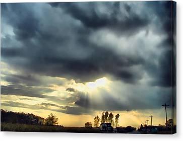 Sky In Turmoil Canvas Print by Tom Schmidt