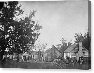 Slaves Sitting Near Their Cabins Canvas Print by Everett