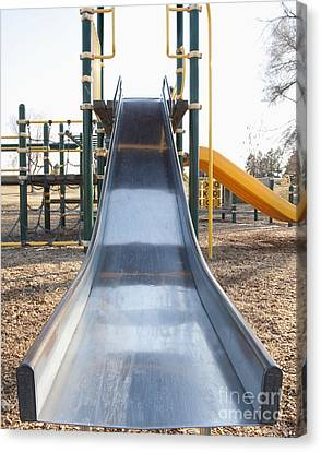 Slide And Playground Equipment Canvas Print by Thom Gourley/Flatbread Images, LLC