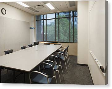 Small Empty Boardroom With A Long Canvas Print by Marlene Ford