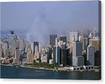Smoke From The Ruins Of The World Trade Canvas Print by Everett