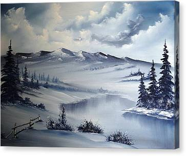 Snow On The Range Canvas Print by John Koehler