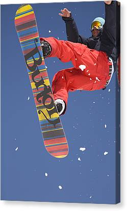 Snowboard Jumping On Vogel Mountain Canvas Print by Ian Middleton