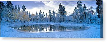 Snowy Lake Canvas Print by David Nunuk