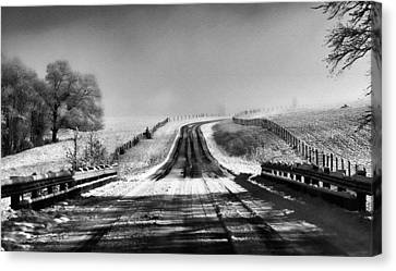 Snowy Road Canvas Print by Brent Craft