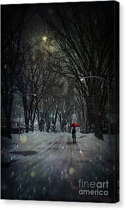 Snowy Winter Scene With Woman Walking At Night Canvas Print by Sandra Cunningham