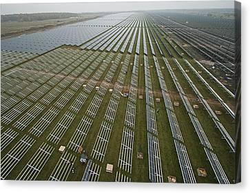 Solar Panels On Brackets Arrayed Canvas Print by Michael Melford