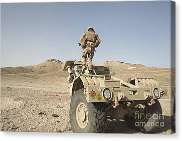 Husky Canvas Print - Soldier Climbs A Damaged Husky Tactical by Stocktrek Images