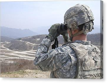 Soldier Observes An Adjust Fire Mission Canvas Print by Stocktrek Images