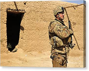 Soldier Stands Guard During A Routine Canvas Print by Stocktrek Images