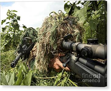 Soldiers Dressed In Ghillie Suits Canvas Print by Stocktrek Images