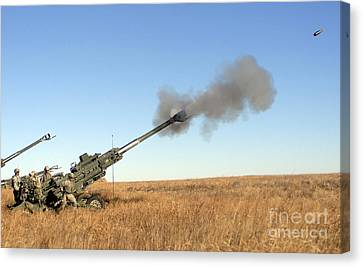 Soldiers Fire A 155mm M777 Lightweight Canvas Print by Stocktrek Images