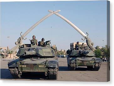Soldiers In An Army Abrams Tank Pose Canvas Print by Everett