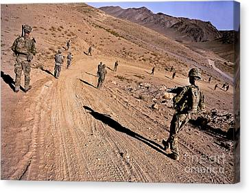 Soldiers Patrol To A Village Canvas Print by Stocktrek Images