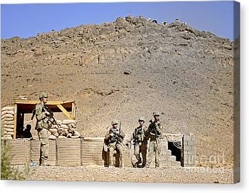 Soldiers Wait For Afghan National Canvas Print by Stocktrek Images