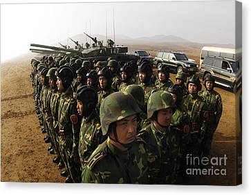 Soldiers With The Peoples Liberation Canvas Print by Stocktrek Images