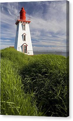Souris Harbour Lighthouse, Souris Canvas Print by John Sylvester