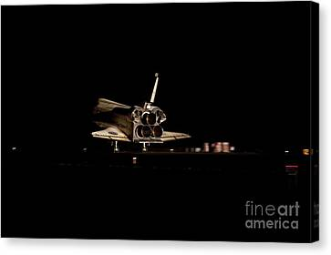Space Shuttle Atlantis Landing At Night Canvas Print by NASA/Science Source