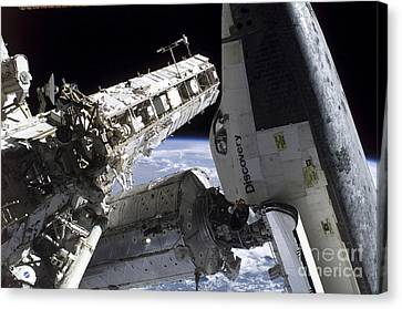 Space Shuttle Discovery Docked Canvas Print by Stocktrek Images